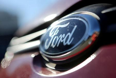 FILE PHOTO: The Ford logo is seen on a car in a park lot in Sao Paulo