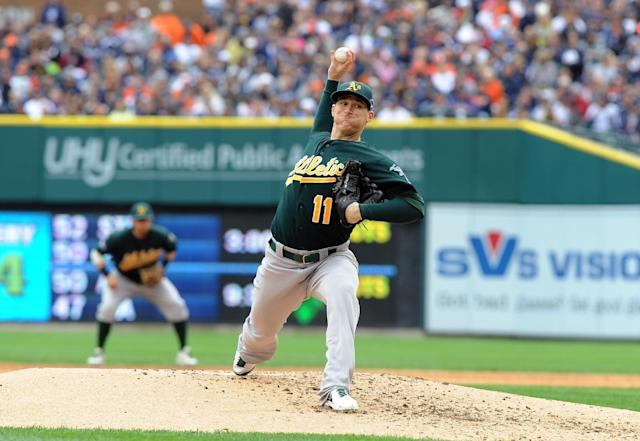 Oakland Athletics starting pitcher Jarrod Parker throws during the third inning of Game 3 of an American League baseball division series against the Detroit Tigers in Detroit, Monday, Oct. 7, 2013. (AP Photo/Lon Horwedel)