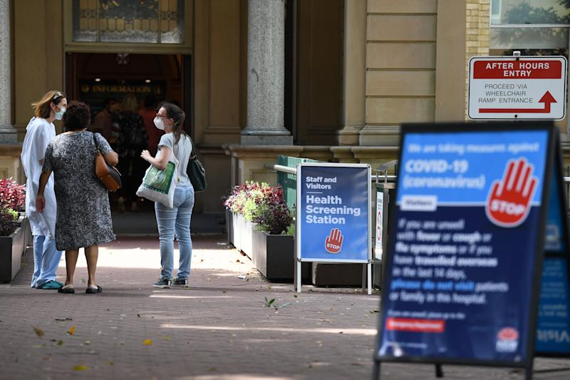 Staff wearing face masks outside the Royal Prince Alfred Hospital in Sydney. Source: AAP