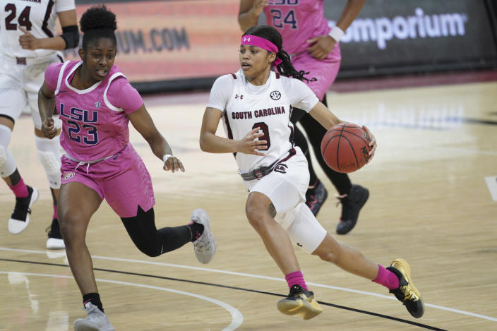 South Carolina guard Destanni Henderson (3) dribbles against LSU guard Karli Seay (23) during the first half of an NCAA college basketball game Sunday, Feb. 14, 2021, in Columbia, S.C. (AP Photo/Sean Rayford)