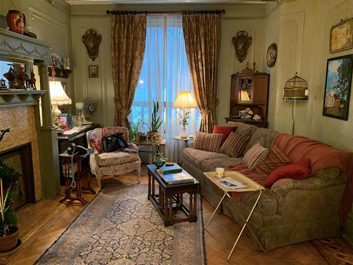 """Baseman sourced fabrics and items from local shops in the Washington Heights neighborhood, such as C&E Fabrics. Shown here is Abuela Claudia's apartment that he notes """"pays homage to the old country"""" with a green palette and romantic florals."""
