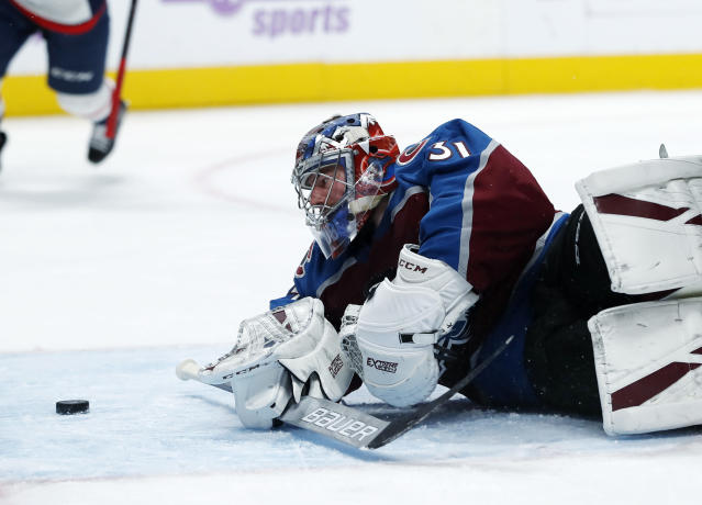 Colorado Avalanche goaltender Philipp Grubauer watches a shot off the stick of Washington Capitals right wing Devante Smith-Pelly go into the net for a goal in the second period of an NHL hockey game Friday, Nov. 16, 2018, in Denver. (AP Photo/David Zalubowski)