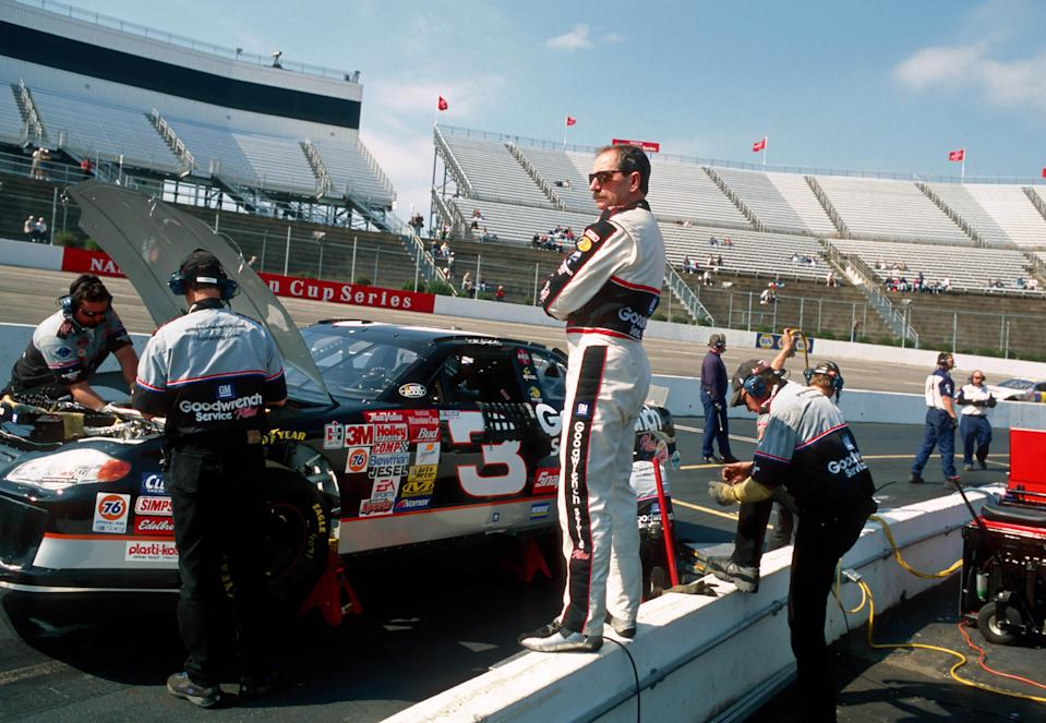 <em>Dale Earnhardt stands on the pit wall at Martinsville Raceway during a practice in 2000 (Brian Spurlock/USA TODAY Sports).</em>