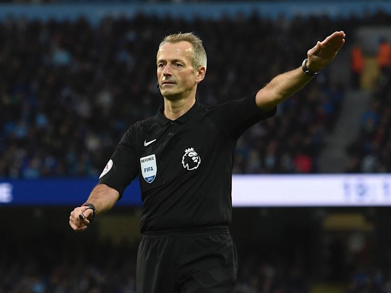 Referee Martin Atkinson let a number of fouls go during the game (Getty)