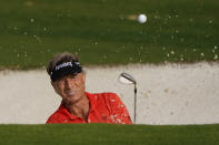 Bernhard Langer, of Germany, watches his bunker shot on the ninth hole during the first round of the Masters golf tournament Friday, Nov. 13, 2020, in Augusta, Ga. (AP Photo/Chris Carlson)