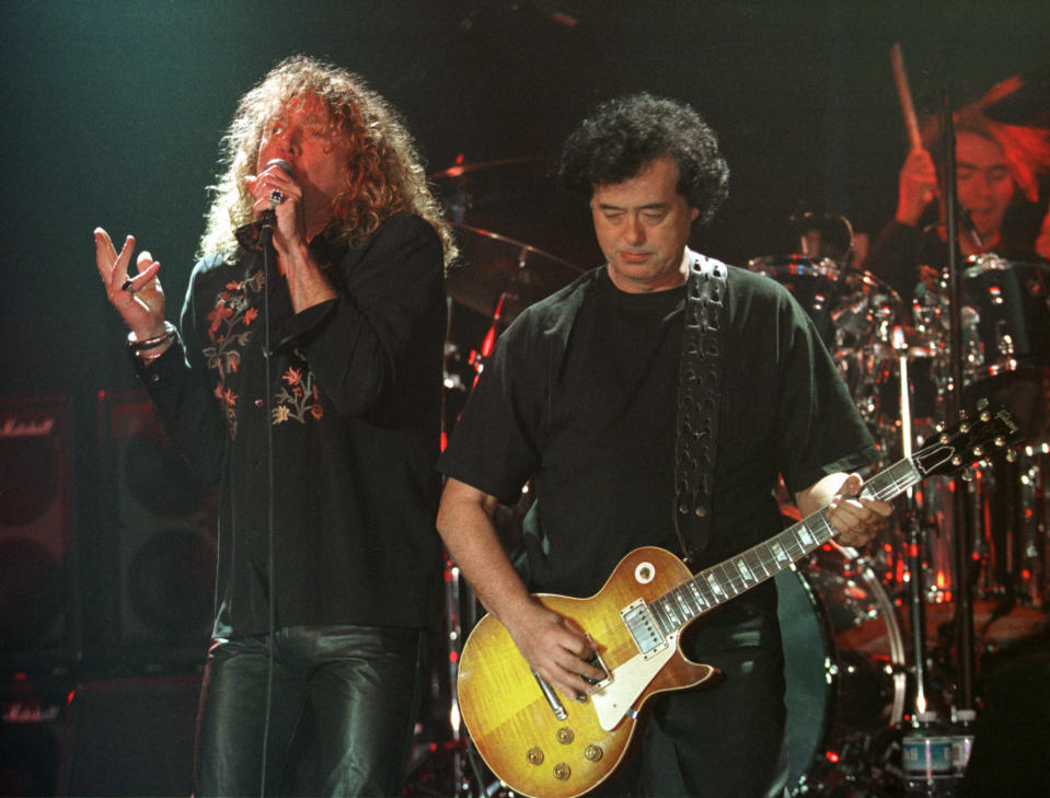 """FILE--In this March 5, 1998, file photo, Led Zeppelin's Robert Plant, left, performs with guitarist Jimmy Page during their concert in Istanbul. A U.S. appeals court on Friday, Sept. 28, 2018, ordered a new trial in a lawsuit accusing Led Zeppelin of copying an obscure 1960s instrumental for the intro to its classic 1971 rock anthem """"Stairway to Heaven.""""  (AP Photo/Murad Sezer, File)"""