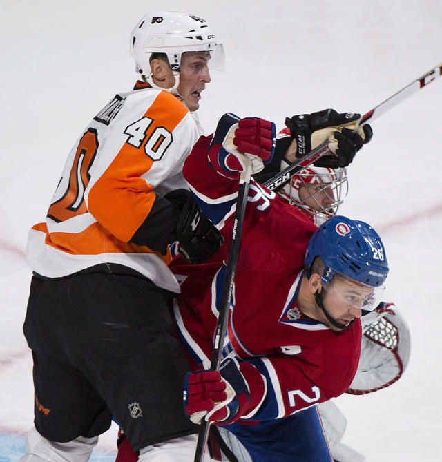 Montreal Canadiens' Josh Gorges, right, defends against Philadelphia Flyers' Vincent Lecavalier, left, as Canadiens goaltender Carey Price, center, watches during the second period of an NHL hockey game in Montreal, Saturday, Oct. 5, 2013. (AP Photo/The Canadian Press, Graham Hughes)