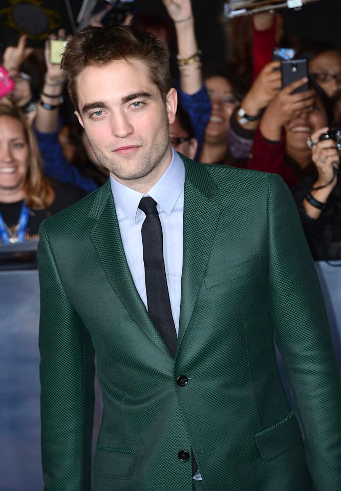 "LOS ANGELES, CA - NOVEMBER 12:  Actor Robert Pattinson arrives at the premiere of Summit Entertainment's ""The Twilight Saga: Breaking Dawn Part 2"" at Nokia Theatre L.A. Live on November 12, 2012 in Los Angeles, California.  (Photo by Michael Buckner/Getty Images)"