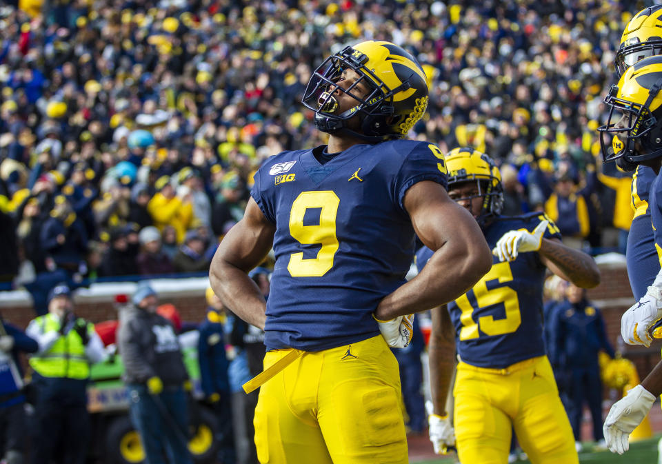 Michigan wide receiver Donovan Peoples-Jones (9) makes a pose to celebrate his touchdown in the third quarter of an NCAA college football game against Michigan State in Ann Arbor, Mich., Saturday, Nov. 16, 2019. Michigan won 44-10. (AP Photo/Tony Ding)