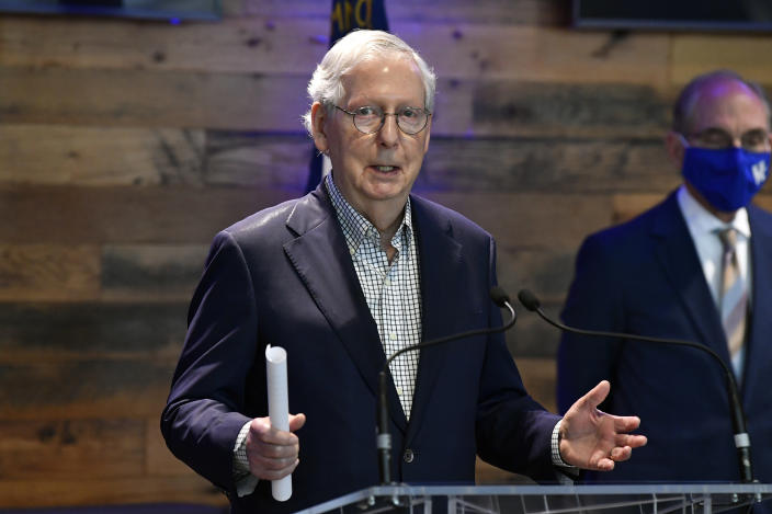 Senate Minority Leader Mitch McConnell, R-Ky., addresses the media at a COVID-19 vaccination site in Lexington, Ky., Monday, April 5, 2021. (AP Photo/Timothy D. Easley)