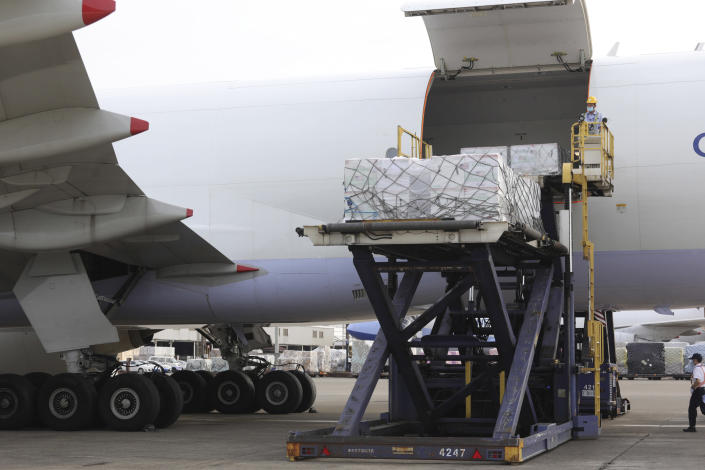 In this photo released by the Taiwan Centers for Disease Control, workers unload COVID-19 vaccines from a China Airlines cargo plane from Memphis that arrived at the airport outside Taipei in Taiwan, Sunday, June 20, 2021. The U.S. sent 2.5 million doses of the Moderna COVID-19 vaccine to Taiwan on Sunday, tripling an earlier pledge in a donation with both public health and geopolitical meaning. (Taiwan Centers for Disease Control via AP)