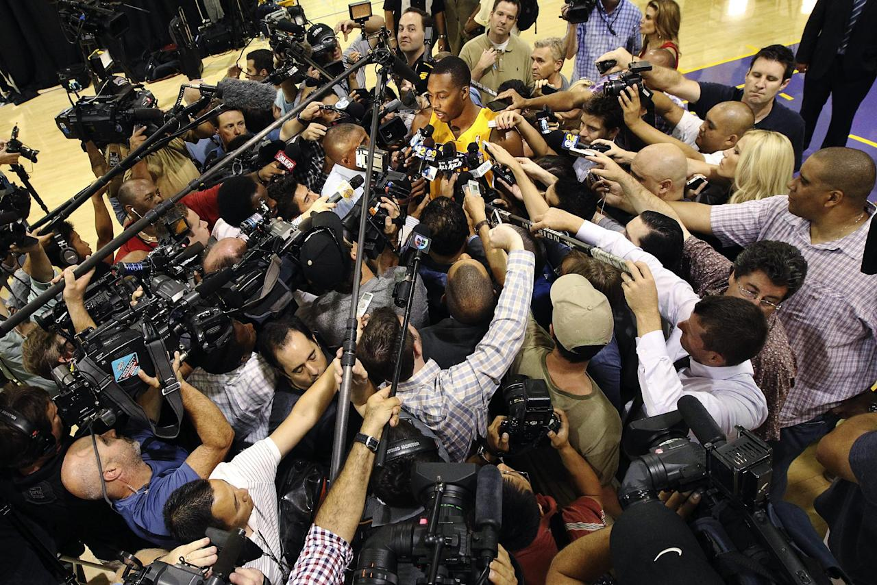 Los Angeles Lakers center Dwight Howard speaks to reporters during their NBA basketball media day at the team's headquarters in El Segundo, Calif., Monday, Oct. 1, 2012. (AP Photo/Reed Saxon)