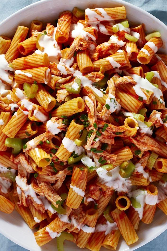 """<p>The buffalo sauce gives pasta salad the kick you didn't know it needed.</p><p>Get the recipe from <a href=""""https://www.delish.com/cooking/recipe-ideas/recipes/a48102/buffalo-chicken-pasta-salad-recipe/"""" rel=""""nofollow noopener"""" target=""""_blank"""" data-ylk=""""slk:Delish"""" class=""""link rapid-noclick-resp"""">Delish</a>.</p>"""