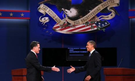 Mitt Romney and President Obama go in for the cordial handshake after their first debate on Oct. 3.