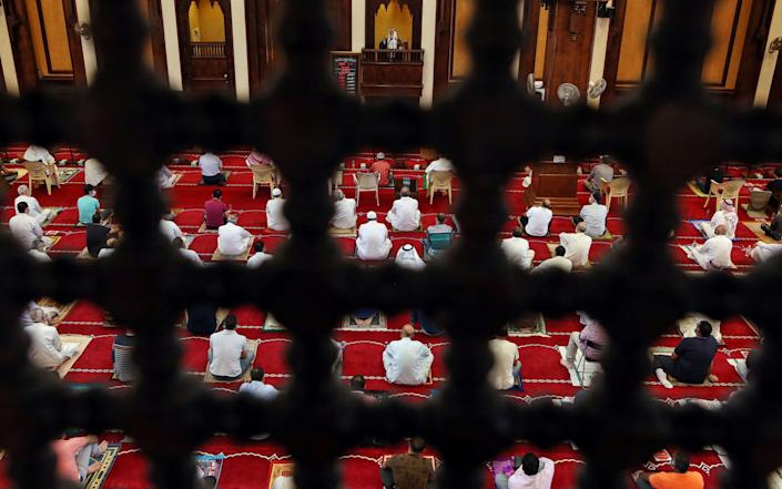 Muslim worshippers attend a sermon during the Friday prayers at a mosque in Kuwait City - AFP