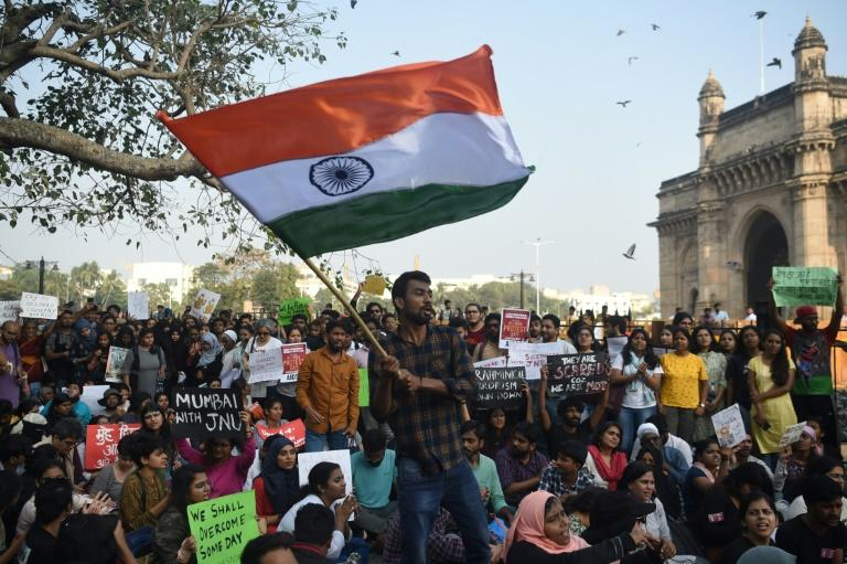 More than 1,000 people held a vigil in Mumbai, India to protest the attack that left students and teachers injured at Jawaharlal Nehru University in New Delhi (AFP Photo/Punit PARANJPE                      )