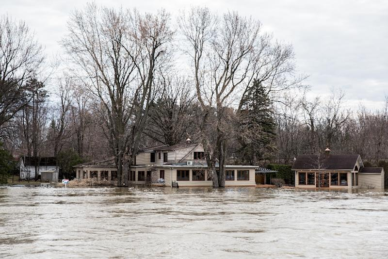 Homes were on the verge of being flooded in Laval, Canada, where water remains at a dangerous level (AFP Photo/MARTIN OUELLET-DIOTTE)