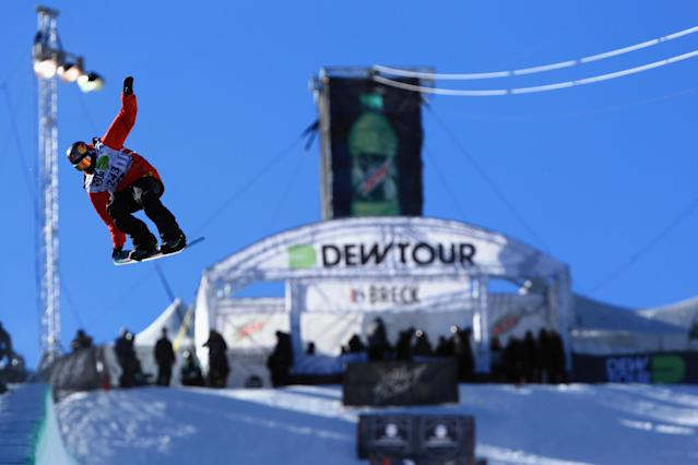 BRECKENRIDGE, CO - DECEMBER 14: Greg Bretz en route to winning the men's snowboard superpipe final at the Dew Tour iON Mountain Championships on December 14, 2013 in Breckenridge, Colorado. (Photo by Doug Pensinger/Getty Images)