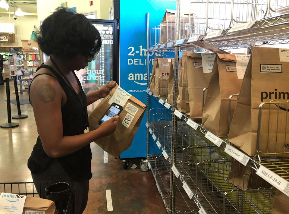 A Whole Foods shopper prepares a delivery order. REUTERS/Lisa Baertlein