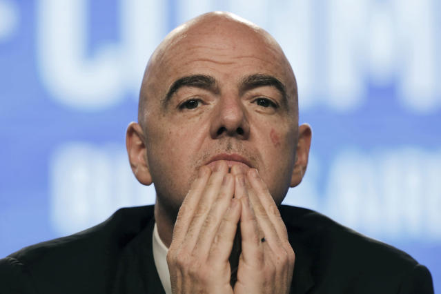 FILE - In this April 12, 2018 file photo, FIFA President Gianni Infantino participates in the annual conference of the South American Football Confederation, CONMEBOL, in Buenos Aires, Argentina. Infantino has asked the emir of Qatar to consider co-hosting the next World Cup with several nations that are attempting to isolate the tiny desert country in a bitter diplomatic dispute. Qatar has just eight stadiums to host 64 games over an already-congested 28-day window in 2022. Expanding the field to 48 teams would mean 80 games, requiring more stadiums. Infantino says using venues in Saudi Arabia and around the Persian Gulf would probably be a nice message. (AP Photo/Martin Ruggiero, File)