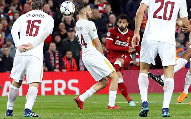 "After a performance which Lionel Messi and Cristiano Ronaldo would have been proud to look back upon the question can be asked: is Mohamed Salah moving into a sphere in which he can be discussed as their possible successor? Is the Liverpool forward already a genuine Ballon d'Or contender? Ronaldo is 33; Messi is 30. Salah is, at 25, coming into his prime years. It had long been assumed that Neymar, at 26, would eventually be taking the mantle as the world's best player and part of the Brazilian's motivation for his world-record move to Paris St-Germain was to step away from Messi; to be number one in his own right. He still has a lot of work to do. Salah's season has changed the debate. It has been Messi or Ronaldo since Kaka won the Ballon d'Or in 2007. Ronaldo was second that year, Messi third. Since then the pair have been either first or second – apart from 2010 when Andrés Iniesta was runner-up to Messi – winning it 10 times between them (five times each). No player from an English club has even made the final three since Ronaldo won it in 2008 while still at Manchester United. Before that Thierry Henry was runner-up with Arsenal in 2006 and Frank Lampard finished second in 2005 and Steven Gerrard third in the same year. Liverpool won the Champions League that year, of course, and now Salah has taken them to the brink of another final with his unforgettable display against his former club Roma, when he became the first player to score twice and, selflessly, provide two assists in a semi-final of the competition. Mo Salah in Egypt The comparison with Gerrard is a worthy one, and that comparison stretches back even further to Kenny Dalglish: two brilliant individuals within the collective. Salah is moving into that company, he is earning that status, and it goes way beyond the numbers as he collected goals number 42 and 43 (in 47 matches) at Anfield on Tuesday night. There can be no doubt that should Liverpool win the Champions League again then Salah will at least be on that Ballon d'Or shortlist. After that it is a question of whether what he has done can dislodge the huge global block votes that Messi and Ronaldo enjoy year-after-year and, in fairness, should Ronaldo propel Real Madrid to yet another Champions League triumph of their own then he would be the favourite. Going into the semi-final against Bayern Munich it must also be remembered that Ronaldo has 42 goals – one fewer than Salah – but in 39 games. It is not just about the numbers and the trophies, though. I voted for David Silva for the Football Writers' Footballer of the Year award and did so because of his enduring brilliance, how he is the oil in the machine of this magnificent Manchester City side, but I was wrong. The award should go – and will no doubt go – to Salah who has already won the Professional Footballers' Association's award. He has surged way beyond what any other player in England has achieved and has that aura about him that only the very best can create. liverpool roma grid The Ballon d'Or criteria was changed in 2016 with Fifa breaking away to award its own world player of the year prize but still covers ""on-field performance and overall behaviour on and off the pitch"" and Salah is a strong candidate to fulfil those points. His behaviour has been impeccable. There is another dimension to Salah, the African Player of the Year, and that is what he means to Egypt where he is such an iconic role model and who he will lead to the World Cup. In a group with hosts Russia, Uruguay and Saudi Arabia it is certainly possible to see them progressing to the last-16 which would enhance his status even more. Salah's two goals against Roma were wonderful. The second, a trademark dink after a surging run, but the first was just perfect as his curling shot kissed the cross-bar on its way into the goal. A perfect goal in a perfect season for Salah."