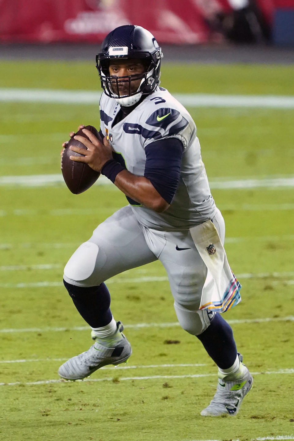 Seattle Seahawks quarterback Russell Wilson (3) looks to throw against the Arizona Cardinals during the first half of an NFL football game, Sunday, Oct. 25, 2020, in Glendale, Ariz. With the NFC East a total mess, the conference's West Division is so strong that three teams, possibly all four, figure to challenge for the playoffs. (AP Photo/Rick Scuteri)