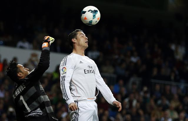 Real Madrid's Ronaldo and Levante's goalkeeper Navas fight for the ball in Madrid