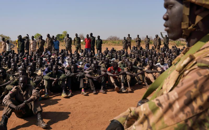 South Sudan soldiers gather at the training site for the joint force to protect VIPs in Gorom outside Juba