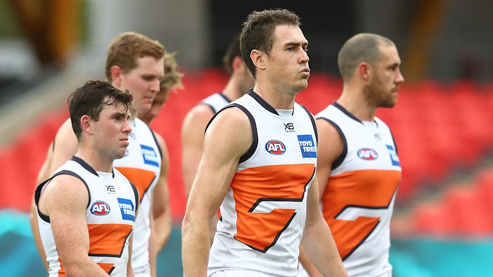 GWS star Jeremy Cameron is pictured here alongside teammates.