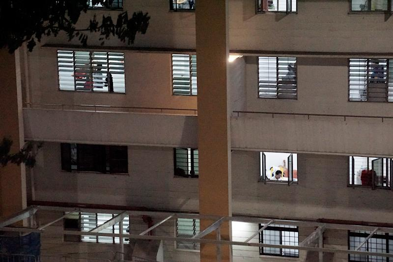Migrant workers seen inside a formerly vacant HDB block at Redhill Close, which has been repurposed to accommodate healthy workers amid a spike in COVID-19 cases linked to foreign worker dormitories, on 10 April 2020. (PHOTO: Dhany Osman / Yahoo News Singapore)