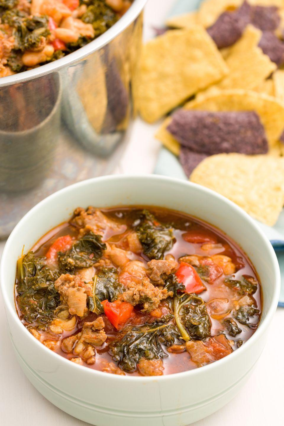 """<p>This Italian-inspired chili is packed with spicy turkey sausage and leafy kale for a tomato-y chili.</p><p>Get the recipe from <a href=""""https://www.redbookmag.com/cooking/recipe-ideas/recipes/a45520/spicy-turkey-sausage-kale-chili-recipe/"""" rel=""""nofollow noopener"""" target=""""_blank"""" data-ylk=""""slk:Delish"""" class=""""link rapid-noclick-resp"""">Delish</a>.</p>"""