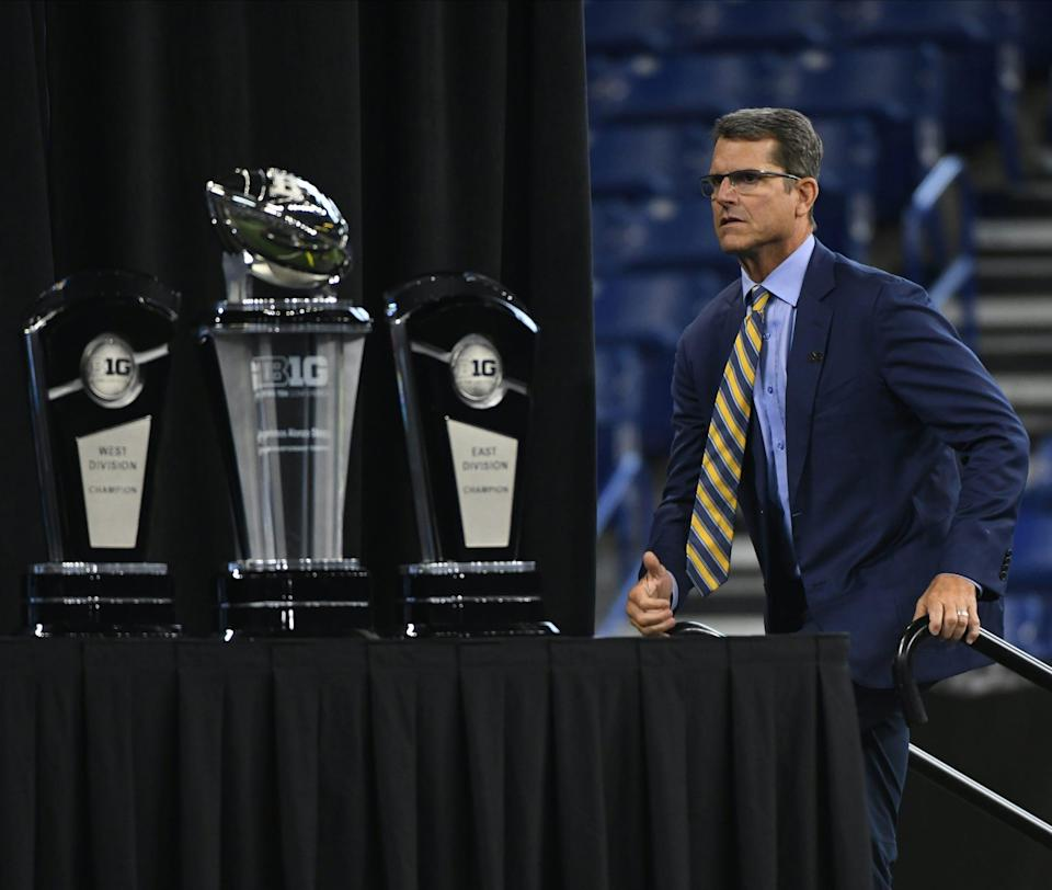 Jim Harbaugh as close to the Big Ten trophy as he's every been... physically, that is.