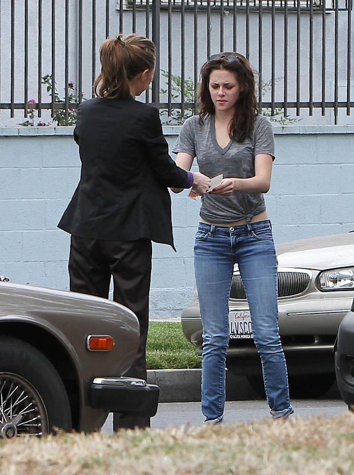 "Kristen Stewart had some car trouble in Los Angeles on Thursday, when another driver caused a fender bender with her Mini Cooper and exchanged information with the actress. Miguel Aguilar/Juan Sharma/<a href=""http://www.pacificcoastnews.com/"" target=""new"">PacificCoastNews.com</a> - July 14, 2011"