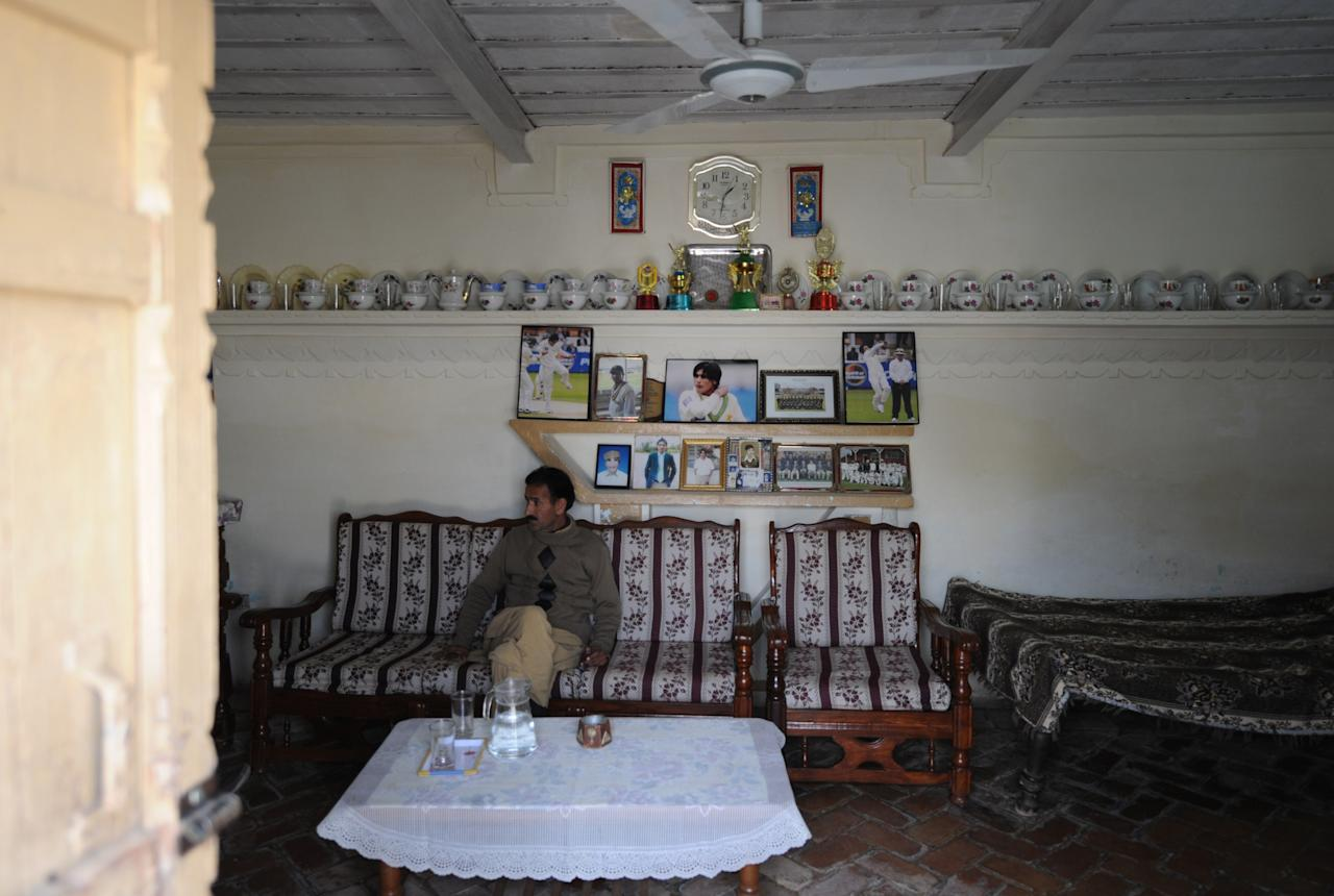 Muhammad Ashraf, brother-in-law of former Pakistani cricketer Mohmammad Aamer sits in front of photographs of Aamer displayed in a room at the family residence in Changa Bangial village some 73 kilometres east of Islamabad on Febraury 2, 2012. Mohammad Aamer will announce his next move when he returns home later this month after his release from a British prison, his brother told AFP. Aamer was one of three Pakistan players jailed by a judge in London in November 2011 over their roles in a plan to bowl deliberate no-balls during a Test against England at Lord's in August 2010. (AAMIR QURESHI/AFP/Getty Images)