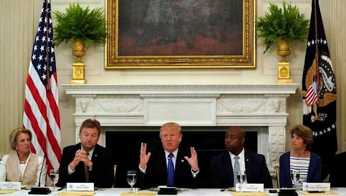 Republican Sens. Shelley Moore Capito, Dean Heller, Tim Scott and Lisa Murkowski join President Trump at a lunch meeting to discuss health care. (Photo: Kevin Lamarque/Reuters)