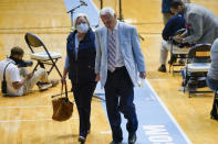 North Carolina Head Basketball Coach Roy Williams and his wife Wanda leave the court after news conference, Thursday, April 1, 2021, in Chapel Hill, N.C. Williams is retiring after 33 seasons and 903 wins as a college basketball head coach. The Hall of Fame coach led the University of North Carolina to three NCAA championships in 18 seasons as head coach of the Tar Heels. (AP Photo/Gerry Broome)