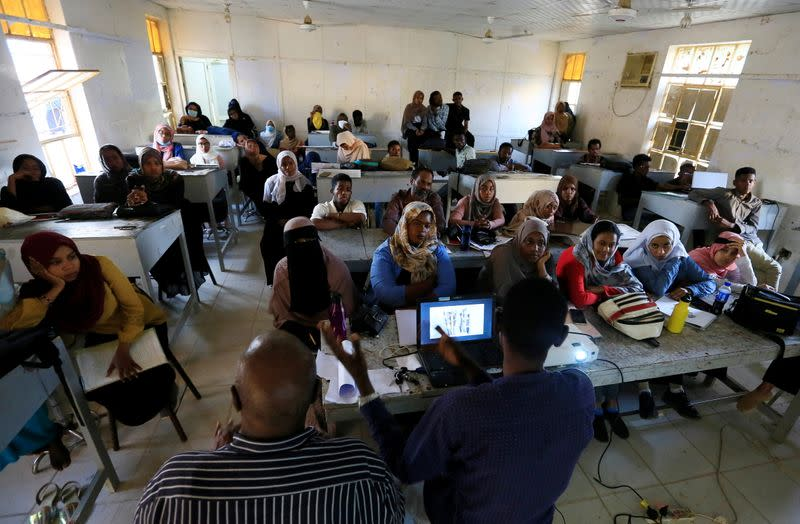 Hearing-impaired students attend a class at the College of Fine and Applied Arts in Khartoum