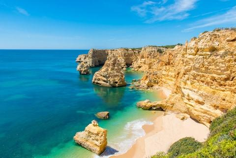 Britons are choosing to bring their children to the beaches of the Canaries or the Algarve (above) before booking a seaside staycation - Credit: SIMON DANNHAUER