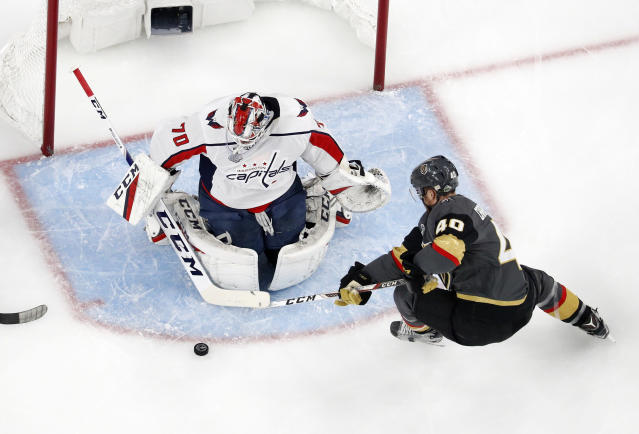 Vegas Golden Knights center Ryan Carpenter, right, tries to get a shot past Washington Capitals goaltender Braden Holtby during the first period in Game 2 of the NHL hockey Stanley Cup Finals on Wednesday, May 30, 2018, in Las Vegas. (AP Photo/John Locher)