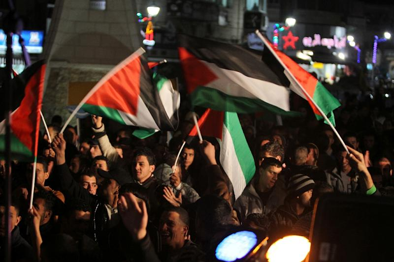 Palestinians celebrate New Year's Eve in the West Bank city of Ramallah in 2012
