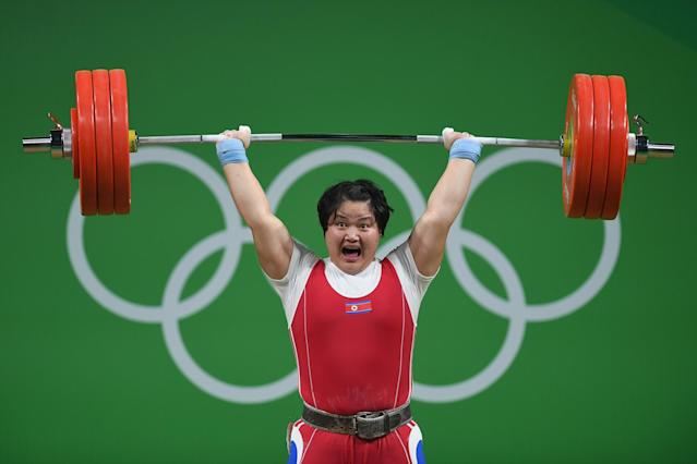 <p>Kuk Hyang Kim of North Korea competes during the Weightlifting – Women's +75kg Group A on Day 9 of the Rio 2016 Olympic Games at Riocentro – Pavilion 2 on August 14, 2016 in Rio de Janeiro, Brazil. (Photo by Laurence Griffiths/Getty Images) </p>