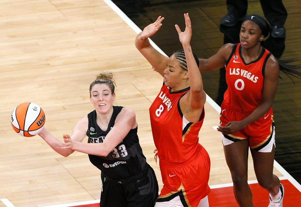 Katie Lou Samuelson, left, in action with the WNBA's Seattle Storm during a June 27, 2021 game against the Las Vegas Aces.