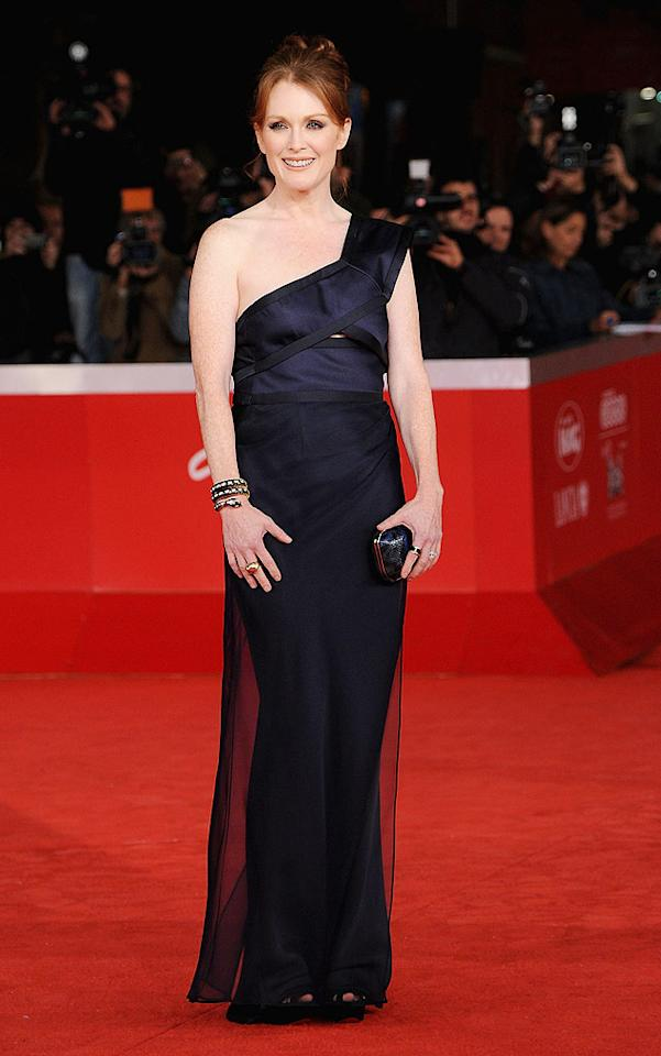 "Also looking amazing in Italy ... four-time Oscar nominee Julianne Moore, who arrived for a screening of ""The Kids Are All Right"" in a one-shoulder Giorgio Armani masterpiece, which she paired with a Bulgari clutch and matching snake cuff. Venturelli/<a href=""http://www.wireimage.com"" target=""new"">WireImage.com</a> - November 2, 2010"