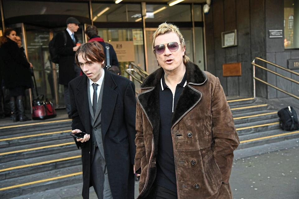 Gene Gallagher, left, and The Prodigy founder Liam Howlett arrive in court last February (Jeremy Selwyn)