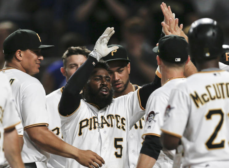 Josh Harrison is congratulated by teammates after hitting a walk-off home run to beat the Los Angeles Dodgers and break up the no-hitter by Dodgers starting pitcher Rich Hill. (AP)