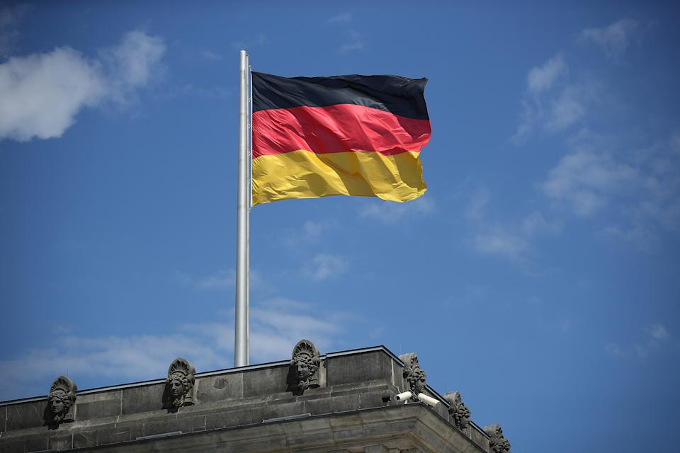 BERLIN, GERMANY - JULY 02:  A German flag flies over a corner of the Reichstag on July 2, 2018 in Berlin, Germany. The future of the present German government is uncertain as German Chancellor and leader of the Chistian Democrats (CDU) Angela Merkel and German Interior Minister and leader of the Bavarian sister party of the CDU, the CSU, Horst Sehhofer, remain locked in an uncompromising deadlock over migration policy.  (Photo by Sean Gallup/Getty Images)