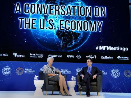 """U.S. Treasury Secretary Steven Mnuchin (R) and IMF Managing Director Christine Lagarde hold """"A Conversation on the US Economy"""", as part of the IMF and World Bank's 2017 Annual Spring Meetings, in Washington, U.S., April 22, 2017.   REUTERS/Mike Theiler"""
