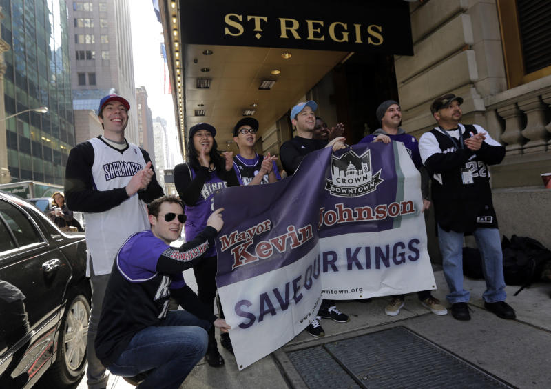 Sacramento Kings supporters gather outside the hotel where NBA owners are meetings regarding the possible relocation of the Sacramento Kings team to Seattle, in New York, Wednesday, April 3, 2013. Hedge fund manager Chris Hansen and Microsoft Chief Executive Steve Ballmer have agreed to buy a majority stake in the Kings from the Maloof family for $341 million, but the deal needs league approval. (AP Photo/Richard Drew)