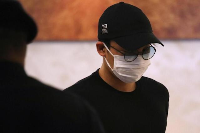 Japanese badminton player Kento Momota arrives at Kuala Lumpur International Airport, as he leaves for Tokyo, after he was released from hospital following an injury in a vehicle collision on Monday, in Sepang