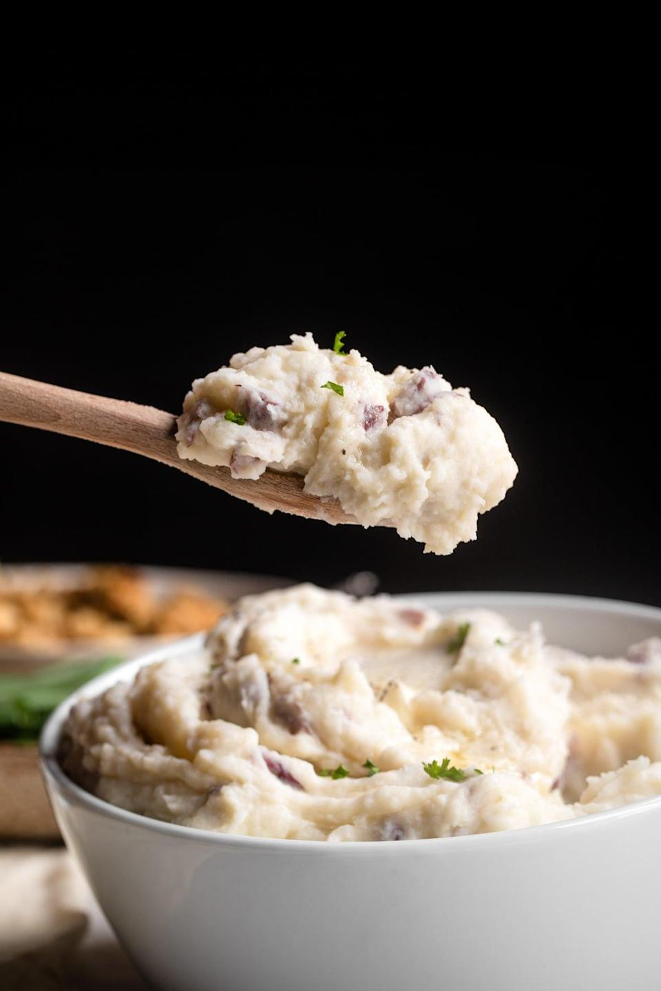 """<p>Eat mashed potatoes that make you feel good when you experiment with this healthy recipe. Complex carbohydrates and vitamins can be found in red potatoes, providing your body with the energy and vitamin C it needs. Top 'em off with some gravy, and you'll be basking in true dinnertime happiness.</p> <p><strong>Get the recipe</strong>: <a href=""""https://www.foodfaithfitness.com/red-skin-mashed-potatoes/?utm_source=feedburner&utm_medium=feed&utm_campaign=Feed%3A+foodfaithfitness%2FryFv+%28Food+Faith+Fitness%29"""" class=""""link rapid-noclick-resp"""" rel=""""nofollow noopener"""" target=""""_blank"""" data-ylk=""""slk:red skin mashed potatoes"""">red skin mashed potatoes</a></p>"""